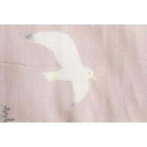 Seagulls sur fond rose