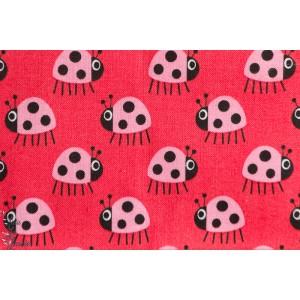 tissu popeline coton Coccinelles rose sur fond rouge